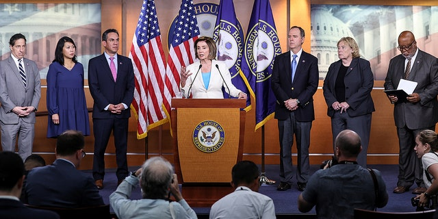 U.S. House Speaker Nancy Pelosi (D-CA) is flanked by House Democratic leaders as she discusses the formation of a select committee to investigate the January 6 attack on the U.S. Capitol during her weekly news conference in Washington, U.S., July 1, 2021. REUTERS/Jonathan Ernst