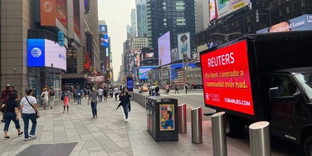 """Accuracy in Media sent a mobile billboard to the Reuters' New York City office that said, """"Reuters: The best comrade a communist ever had!"""""""