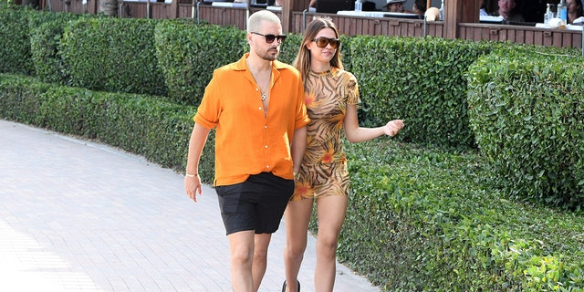 Scott Disick and Amelia Hamlin are seen walking at the beach on April 7, 2021 in Miami.