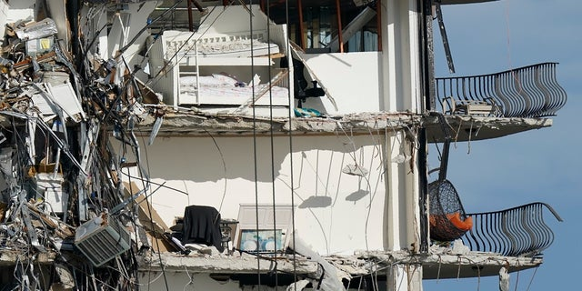 Furniture sits perched in the remains of apartments sheared in half, in the still standing portion of the Champlain Towers South condo building, more than a week after it partially collapsed. (AP)