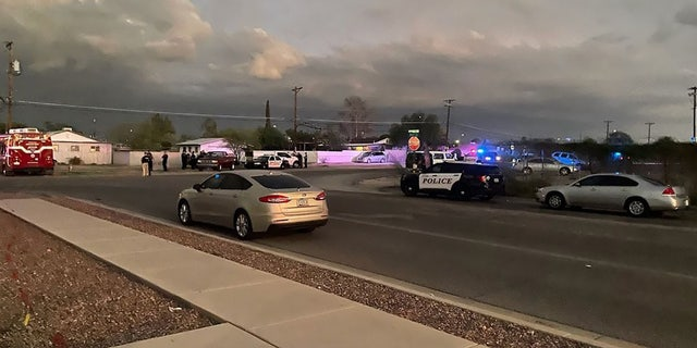 This photo posted to Facebook by the Tucson Police Department shows the scene of a house fire and deadly shooting Sunday.