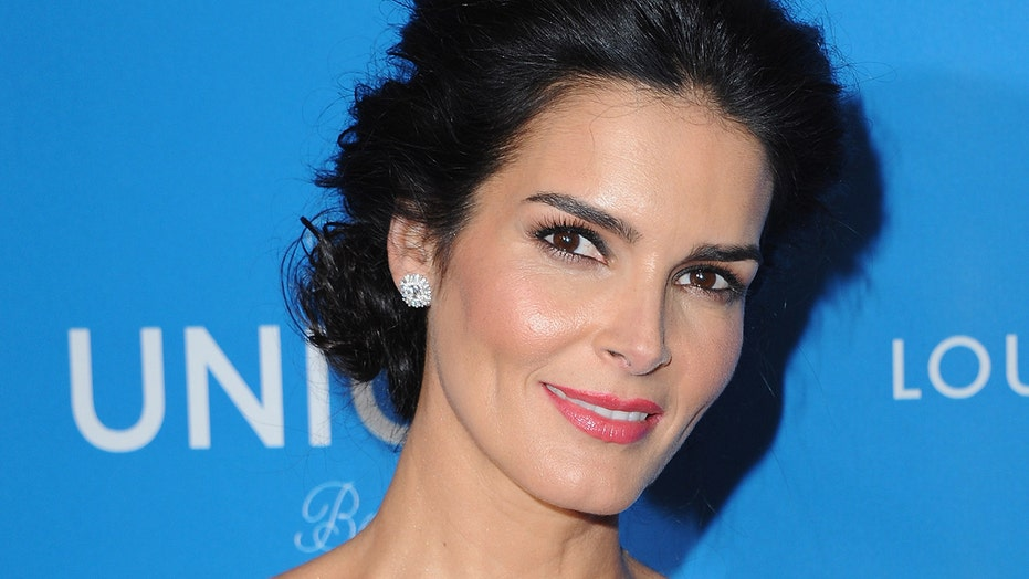 Angie Harmon wows fans in sunny bikini snapshot while swimming with stingrays: 'Happy Monday!'