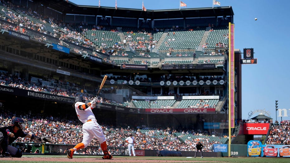 Crawford homers, Giants assured MLB's top record at break