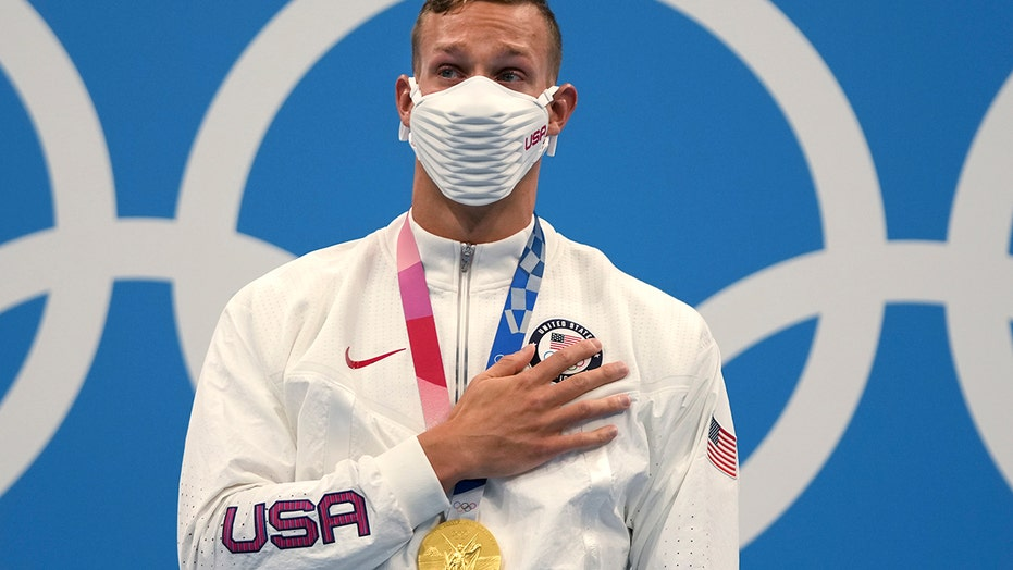 Olympian Caeleb Dressel tears up on gold medal stand while national anthem plays