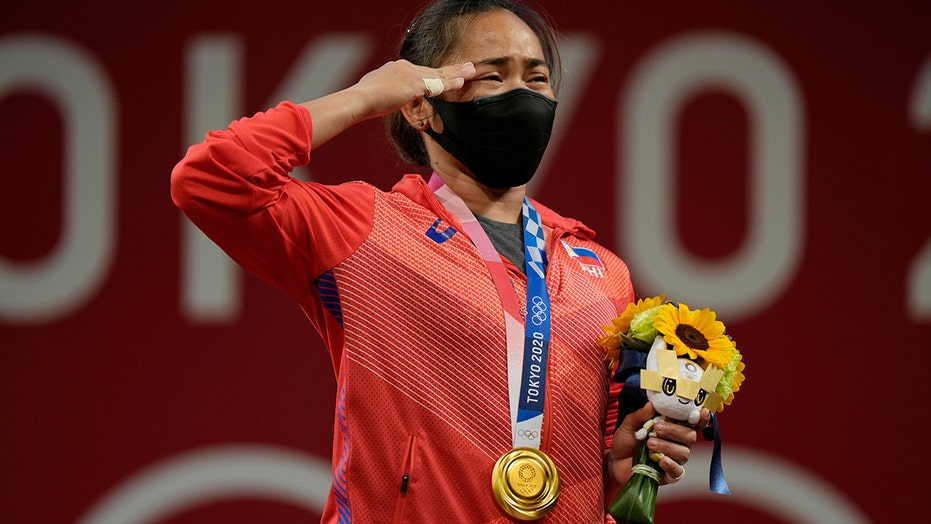 Philippines' first Olympic gold medalist will receive cash, new condo