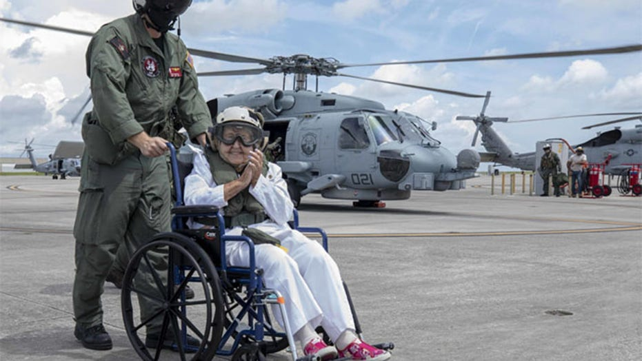 Navy flies widow around ship named after her husband for 100th birthday
