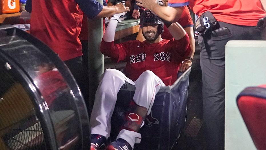 Martinez, Renfroe lift Red Sox over Royals 6-2 amid delays