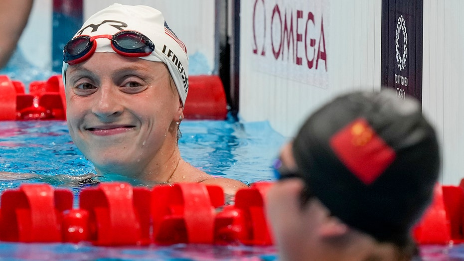 Katie Ledecky earns Olympic record, silver medal in busy day