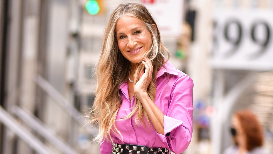 Sarah Jessica Parker beams in regal pink dress as she's seen filming 'Sex and the City' reboot with co-stars