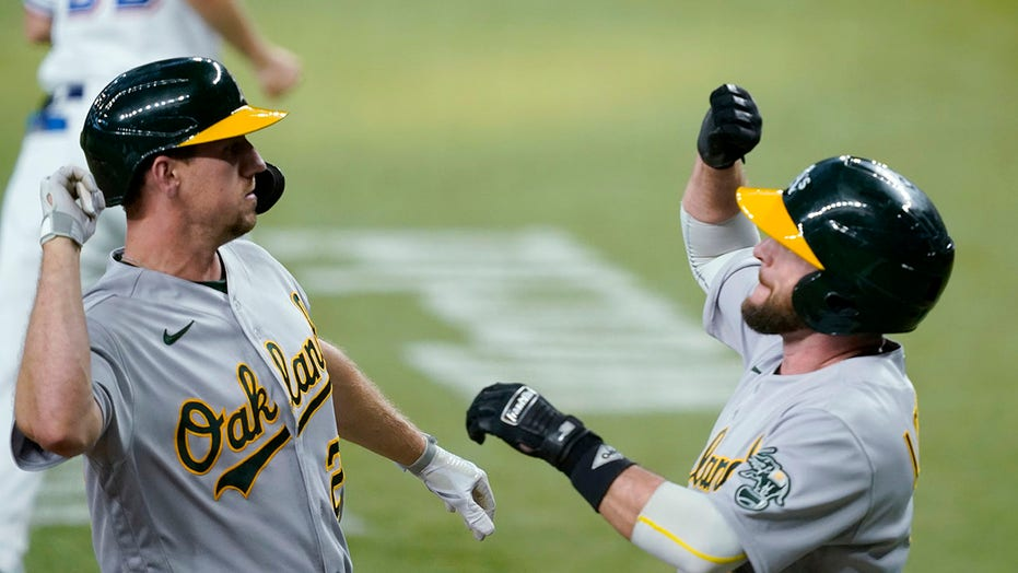 Oakland 4 runs in 11th to beat Rangers 8-4 in game of solos
