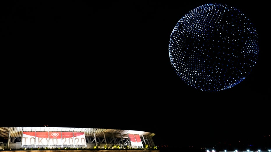 Tokyo Olympics opening ceremony sees drones form rotating Earth over stadium