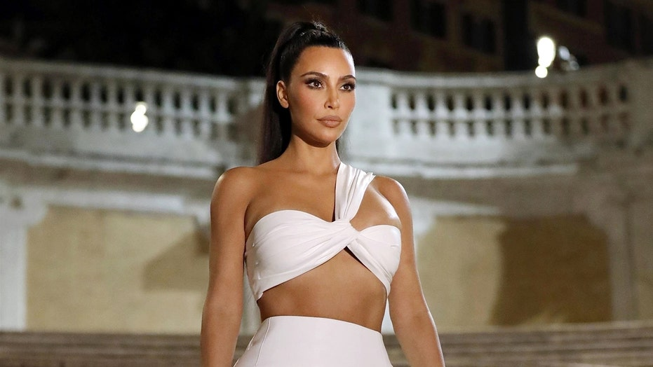 Kim Kardashian wows in revealing white dress on Spanish Steps after facing flack for sexy getup at Vatican
