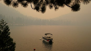 California fire advances toward Lake Tahoe after destroying hundreds of homes