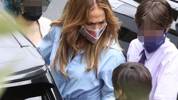 Jennifer Lopez appears to scold one of her children while out with Ben Affleck
