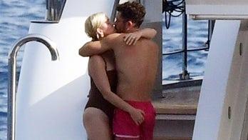 Katy Perry grabs handful of Orlando Bloom during Italian getaway