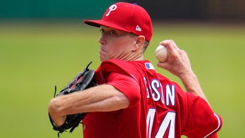 Gibson excels in Phils debut; Realmuto, Harper pound Pirates