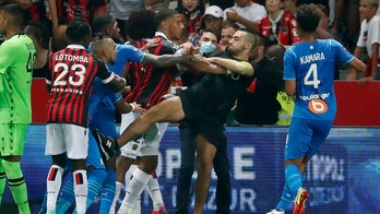 Nice-Marseille Ligue 1 match under review following chaos between players, fans