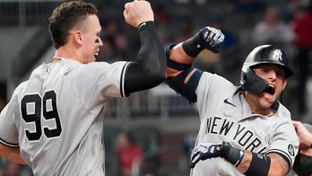 Yankees hit 3 HRs, hold off Braves 5-4 for 11th straight win