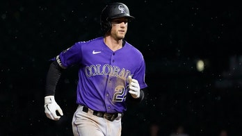 McMahon goes deep in 10th, Rox split long twinbill with Cubs