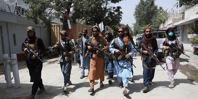 Taliban fighters patrol in the Wazir Akbar Khan neighborhood in the city of Kabul, Afghanistan, Wednesday, Aug. 18, 2021. (AP Photo/Rahmat Gul)