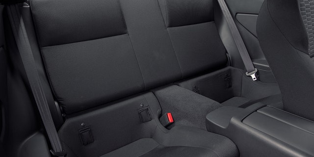 The rear seats are pint-size.