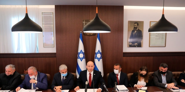 Israeli Prime Minister Naftali Bennett attends a cabinet meeting at his office in Jerusalem, Sunday, Aug. 1, 2021.