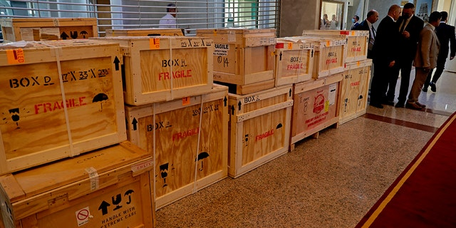 Boxes containing recovered looted artifacts sit temporarily at the foreign ministry before being transferred to the Iraq Museum, in Baghdad, Iraq, Tuesday, Aug. 3, 2021.