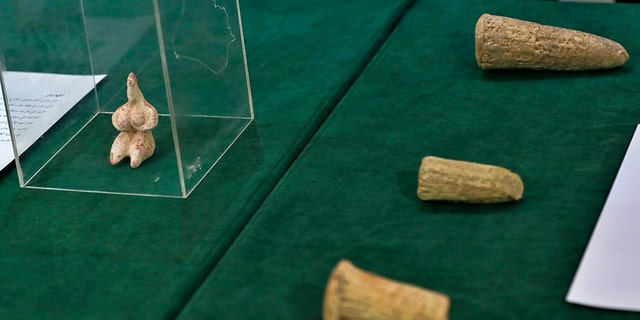 Recently recovered antiquities are displayed at the foreign ministry, in Baghdad, Iraq, Tuesday, Aug. 3, 2021.
