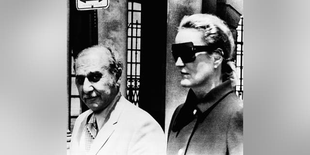 In this June 17, 1971 photo, heiress Doris Duke and her attorney Aram Arabian, leave Superior Court in Providence, R.I.