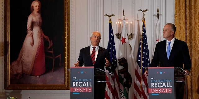 Republican candidate for California Governor John Cox, left, speaks next to fellow candidate Kevin Faulconer during a debate at the Richard Nixon Presidential Library Wednesday, Aug. 4, 2021, in Yorba Linda, Calif. California Gov. Gavin Newsom faces a Sept. 14 recall election that could remove him from office. (AP Photo/Marcio Jose Sanchez)