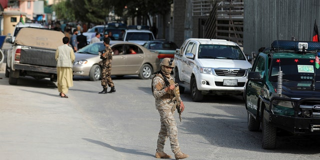 Afghan security personnel arrives at the area where the director of Afghanistan's Government Information Media Center Dawa Khan Menapal was shot dead in Kabul, Afghanistan, Friday, Aug. 6, 2021.