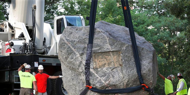 Crews work to remove Chamberlin Rock from Observatory Hill on UW-Madison campus in Madison, Wis., Friday, Aug. 6, 2021. The University of Wisconsin is removing the 70-ton boulder from its Madison campus at the request of minority students who view the rock as a symbol of racism. Chamberlin Rock, on the top of Observatory Hill, is named after Thomas Crowder Chamberlin, a geologist and former university president.   (Kayla Wolf/Wisconsin State Journal via AP)