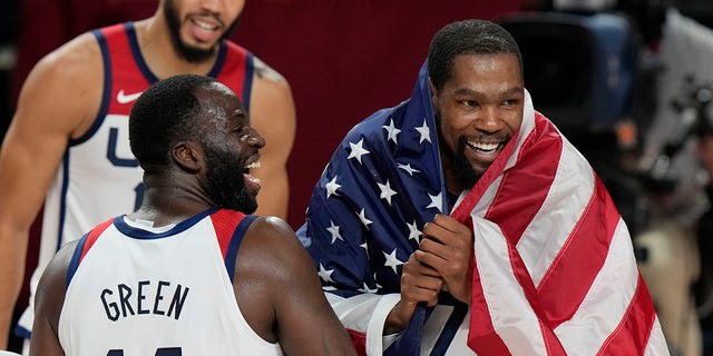 United States' Kevin Durant (7), right, and teammates celebrate after their win in the men's basketball gold medal game against France at the 2020 Summer Olympics, Saturday, Aug. 7, 2021, in Saitama, Japan. (AP Photo/Luca Bruno)
