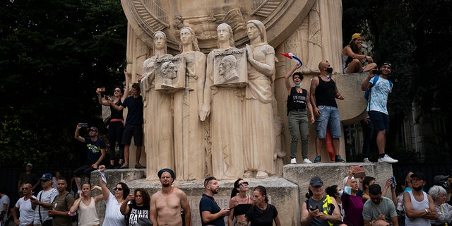Protesters sing chants during a demonstration in Marseille, southern France, Saturday, Aug. 7, 2021.