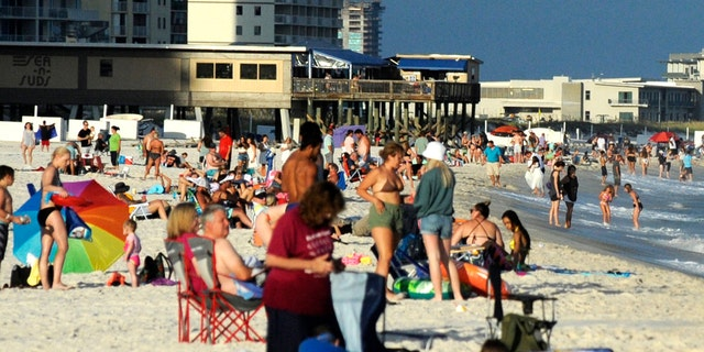 Beachgoers are shown on the coast at Gulf Shores, Alabama, on Thursday, Aug. 12, 2021. (Associated Press)