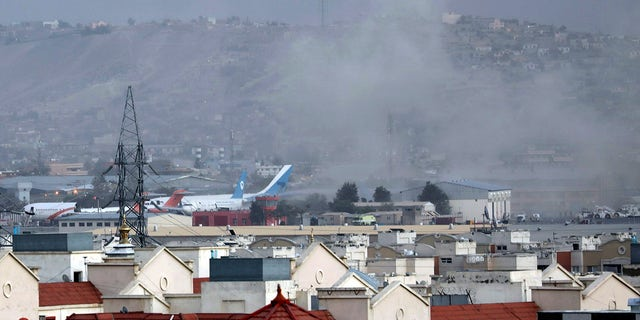 On Thursday, August 26, 2021, smoke rises from a deadly explosion outside the airport in Kabul, Afghanistan. (The Associated Press)