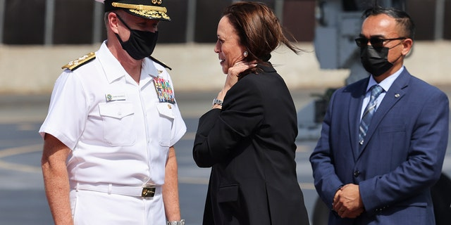 U.S. Vice President Kamala Harris is received by Adm. Samuel Paparo, left, Commander of the U.S. Pacific Fleet, as she arrives at Joint Base Pearl Harbor-Hickam, Hawaii, before continuing to Washington, Thursday, Aug. 26, 2021. (Associated Press)