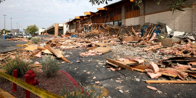 A view of a La Bonita supermarket after the storefront collapsed in Las Vegas, Friday, Aug. 13, 2021. Authorities say several people were treated for unspecified minor injuries after the storefront collapse at the supermarket. (Steve Marcus/Las Vegas Sun via AP)