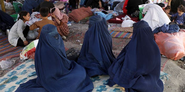 Internally displaced Afghans from northern provinces, who fled their home due to fighting between the Taliban and Afghan security personnel, take refuge in a public park Kabul, Afghanistan, Friday, Aug. 13, 2021. (AP Photo/Rahmat Gul)