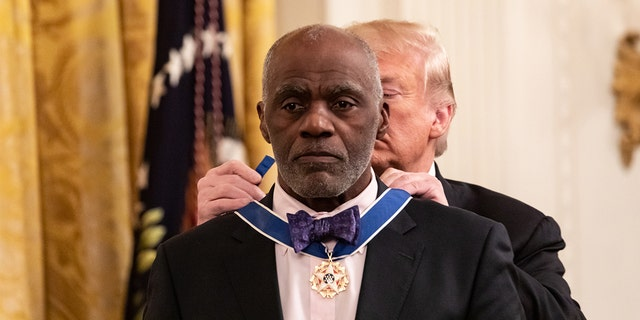 U.S. President Donald Trump presents Alan Page, former Minnesota Supreme Court Justice, and professional football player, with the Presidential Medal of Freedom, in the East Room of the White House in Washington, D.C., on Friday, Nov. 16, 2018. (Cheriss May/NurPhoto via Getty Images)