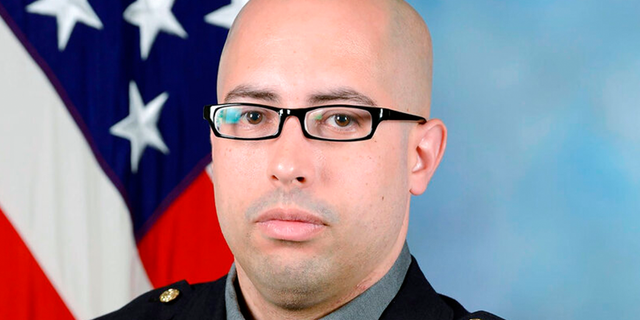 This undated photo provided by the Pentagon Force Protection Agency shows Pentagon Police Officer George Gonzalez.