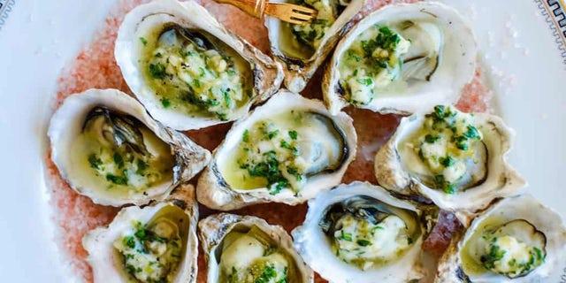 """ザ・ """"BBQ Oysters with Green Chile Garlic Butter"""" recipe is a perfect way to celebrate National Oyster Day."""