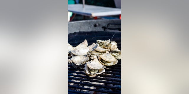 The recipe requires grilling the oysters, either shucking the oysters before grilling, or allowing the heat of the grill to open the oysters.