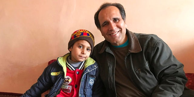 """""""I just basically fell in love with this little boy,"""" Mujtaba said, """"And based on hearing everything, then we knew we had the means and the motivation to help him."""" (Courtesy of Bahaudin Mujtaba via AP)"""