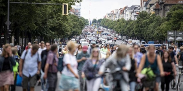 Hundreds have turned out in Berlin to protest the German government's anti-coronavirus measures despite a ban on the gatherings, leading to arrests and clashes with police. (Fabian Sommer/dpa via AP)