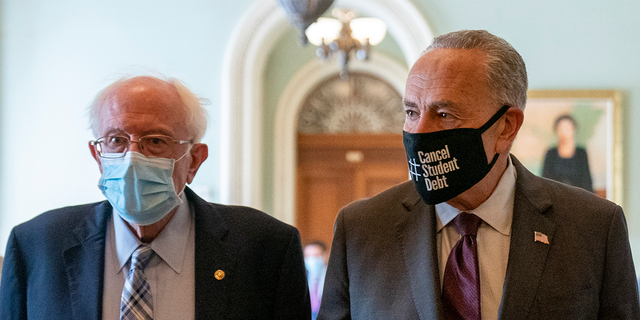 sen.  Bernie Sanders, I-Vt., left, and NY Senate Leader Chuck Schumer, right, walk away from a budget resolution meeting at the Capitol in Washington, Monday, Aug. 9, 2021. Schumer said Wednesday he is confident about spending concerns and inflation of moderate senators won't derail Sanders' reconciliation package.  (AP Photo/Andrew Harnik)
