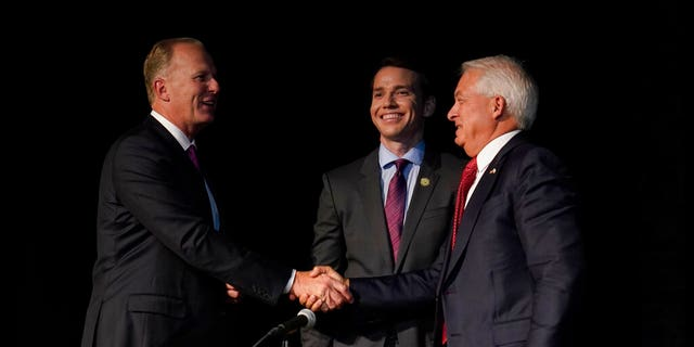 Republican gubernatorial recall candidates, former San Diego Mayor Kevin Faulconer, left, Assemblyman Kevin Kiley, center and businessman John Cox, right, gather together after their debate held by the Sacramento Press Club in Sacramento, Calif., Tuesday, Aug. 17, 2021. (AP Photo/Rich Pedroncelli)