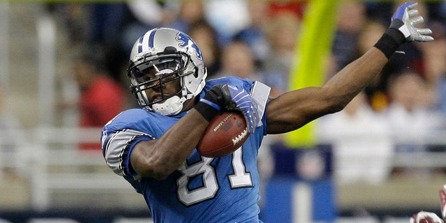 In this Oct. 26, 2008, file photo, Detroit Lions wide receiver Calvin Johnson makes catch against the Washington Redskins in the fourth quarter of an NFL football game in Detroit. Calvin Johnson is simply in awe that he will soon join Jim Brown and Gale Sayers as Pro Football Hall of Famers inducted at the age of 35 years old or younger. (AP Photo/Paul Sancya, File)