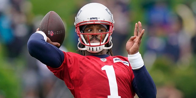 New England Patriots quarterback Cam Newton winds up to pass the ball during an NFL football practice, in this Wednesday, July 28, 2021 file photo, in Foxborough, Mass. (AP Photo/Steven Senne, File)