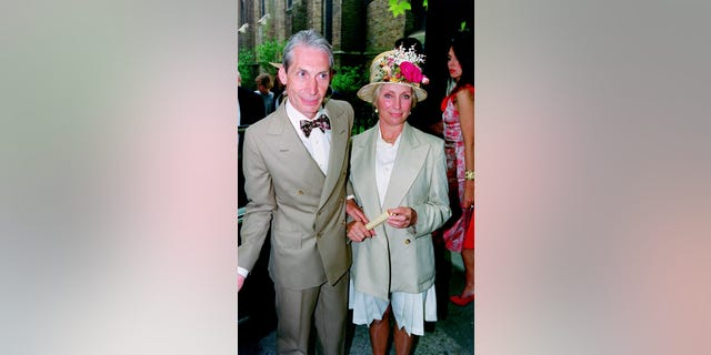 Drummer of The Rolling Stones, Charlie Watts and his wife Shirley Ann Shepherd, attend Georgia May Jagger's christening at Saint Andrew's church, Richmond in 1992. Watts died on August 24 in London surrounded by his family.